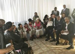 Dr Tedros and Dr Moeti conversing with the family
