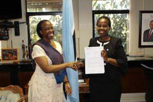 The Honourable Minister of International Affairs and Cooperation, Dr Unity Dow (right), receiving the credentials of the WHO Representative to Botswana, Dr Josephine Namboze (left)