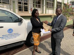 Dr Neena Kimambo, presenting the keys to the Toyota Hilux to the Dr Patrick Aboagye