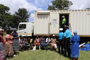 People queuing for TB screening in one of the mobile x ray vans