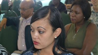 Letisia from UNFPA listening attentively to the presentations on mental health