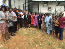 Group photo of the accreditation team with laboratory staff outside the laboratory in Ibadan,