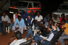 In several instances, meetings are held at night following long hours in the field during the day.