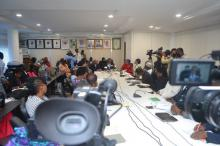 Journalists listening to Dr Alemu's speech during the briefing.