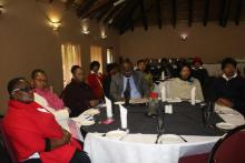 Health officials from the regions listening to presentations during the meeting