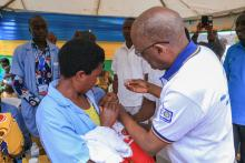 Rotary Club President administering polio vaccine