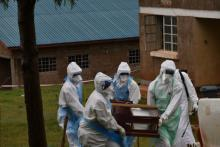 The burial team carrying the body of the second confirmed case for burial in Kween district, eastern Uganda