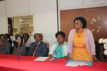 Dr Khosi Mthethwa from WHO addressing the workers while the Minister of Health Honourable Sibongile Ndlela-Simelane, Lugongolweni Member of Parliament Honourable Joseph Souza and Kang-Fa Knitwear Manager Ms Lisa Teng look on.