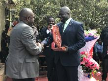 Mr Liyosi, the WHO Representative a.i.  receiving awards from the Governor of Budi state in Yambio.