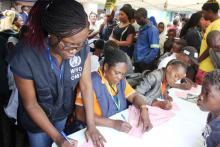 WHO Staff supporting the Cholera vaccination activities in lusaka- Dr. penelope Masumbu at the registration desk