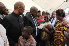 Minister of Health, Hon. Chitalu Chilufya providing a cholera vaccine to a child at the launch of the OCV campaign in Lusaka