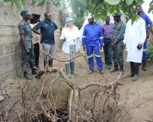 The District Director of Health for Lusaka, Dr. Namani Monze  and the United Nations Resident Coordinator, Ms Janet Rogan view one of the shallow water wells in the community.