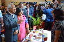 Dr Hon A. Husnoo, Health Minister and Dr (Mrs) M. Timol, Director General Health Services looking at the display of healthy food