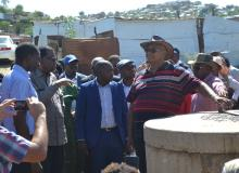 Head of the State with the Minister of Health at one of the drains which were unblocked as part of ongoing efforts to reduce the risk of active transmission
