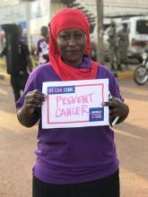 Dr Kasule Hafisa looks holds a commitment placard on the cancer day