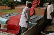 Oral cholera vaccine cold boxes being loaded onto a truck at the routine vaccine stores in Lilongwe ready for transportation to Karonga