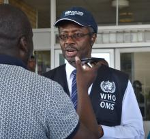 WHO Representative Dr Charles Sagoe-Moses speaking to the media during the Head of State visit to the affected communities