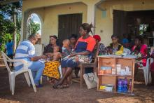 Mrs Ogbaije a corp assessing a sick under-five child