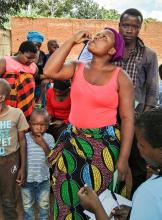 A woman taking the the Oral Cholera Vaccine during the first round of the campaign in Lilongwe