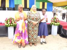 The Guest of Honor, Hon. Vice President posing with some of the girls received vaccination during the occasion
