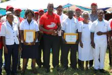 The Minister of Health standing 3rd from left with award winning nurses in tuberculosis treatement and care