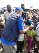 A girl receives a dose of cholera vaccination in South Sudan