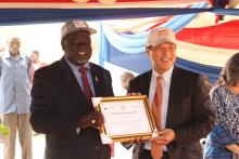 H.E. Seiji Okada, Amb of Japan to South Sudan receiving a certificate of appreciation from Hon MoH.jpg