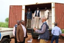 Mr Liyosi and Dr Guyo receiving the vaccines from the Juba Airport warehouse