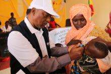 WHO Colleague making marker after vaccinating a child during the launching of mOPV2 vaccination