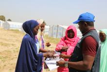 WHO staff provides supportive supervision to anti-malaria mass drug administration team during SMC campaign in Borno state