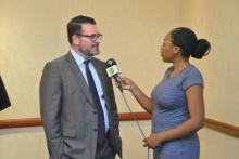 Mr. Andrew Black, Team Leader, Development Assistance at the FCTC Secretariate speaking to a journalist at the launch of the needs assessment report in Lusaka