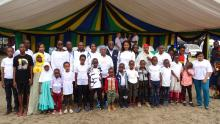 The Guest of Honor with the children who attended the event