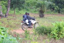 health workers transporting the vaccine on motorbike to remote communities through difficult terrains. Photo credit: WHO/S. Gborie