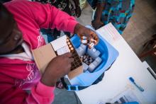 The vaccine is store in a vaccine box with ice packs to keep them at the right temperature unto the time it is administered to the beneficiaries. Photo credit: WHO/M. Duff