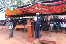 Mr Liyosi speaking to the Governor, top leaders and the community during rally in Tambura, one of the high risk areas bordering DRC