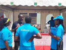 UN staff visit the WHO & UNAIDS stall