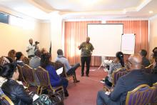 Dr Paul Mainuka delivering a remark during the oppening session of team building workshop