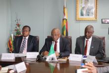 Honorable Minister of Finance and Economic Development; Mr Damoni Kitabire, and Dr Alex Gasasira at the signing ceremony