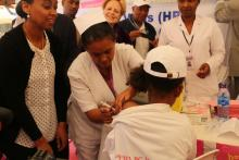 The first girl from Tesfa Kokeb school taking the HPV vaccine