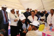 Dr Lia Tadesse vaccinating one of the first 14  year old girls to receive the HPV vaccine nationally.