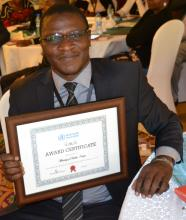 Dr Collins Tabu, head of the National Immunization and Vaccines programme appreciates the MNTE certificate