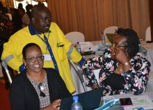 Dr Iheoma Onuekwusi, right, WHO EPI head consults with Immunization ambassador Mr Hillary Kipchumba and partner Amina Mungai, American Red Cross during the event