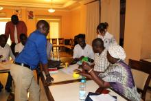 Participants in a practical session on use of the ECD kit.jpg