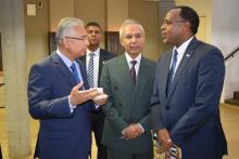Dr Hon P. Jugnauth, Prime Minister of the Republic of Mauritius discussing with Dr Hon. A. Husnoo, Health Minister and Dr L. Musango, WHO Representative in Mauritius