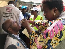 A public official receives the cholera vaccine on May 27, 2019
