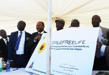 Honorable Minister Moyo showing off the signed pledge to fight tobacco smoking and use of drugs and illicit drug trafficking