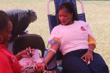 A member of the public donating blood during the commemoration