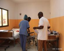 Staff members help a patient at CNRD, June 2019