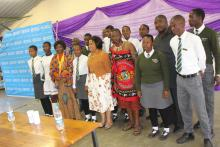 The Minister of Health and the WHO Country Representative with students from Mlumati High School