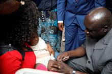 02 WHO OiC vaccinating an eligible child during the launch.jpg